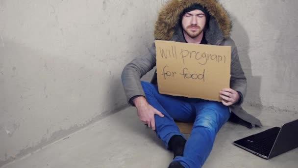 depositphotos_19226407-stock-video-homeless-programmer